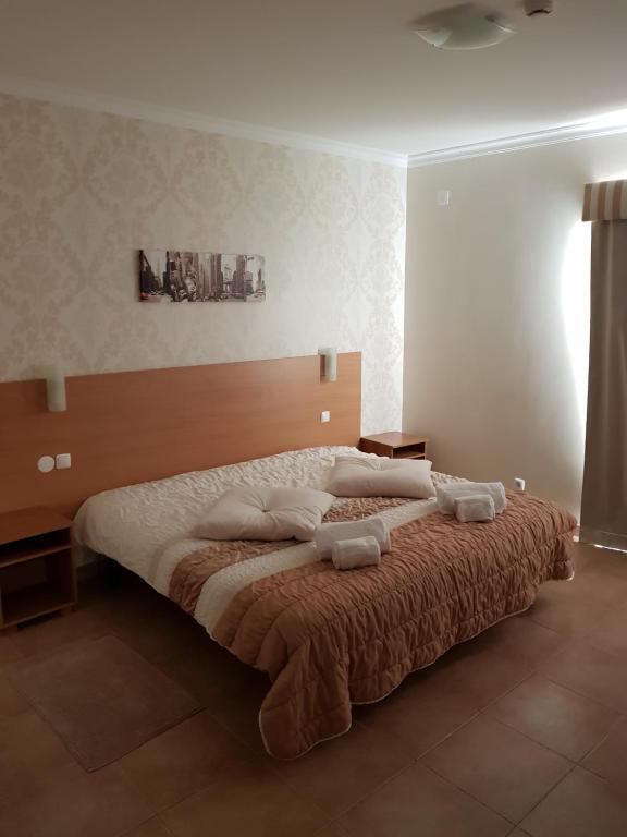 Postel nebo postele na pokoji v ubytování Clube da Lapa