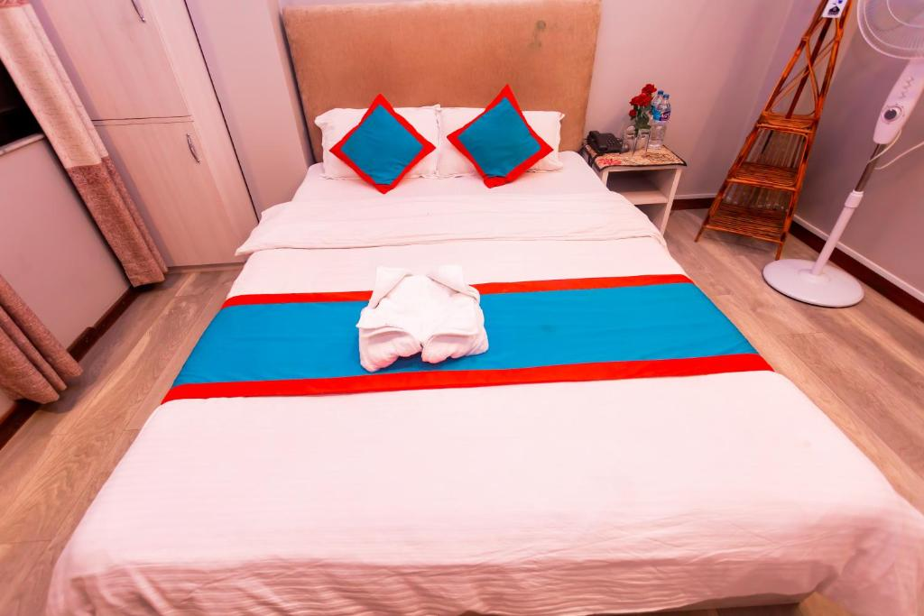 A bed or beds in a room at 8848 Hostel
