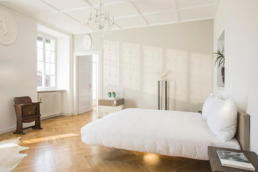 A bed or beds in a room at Caffè dell'Arte Boutique Rooms