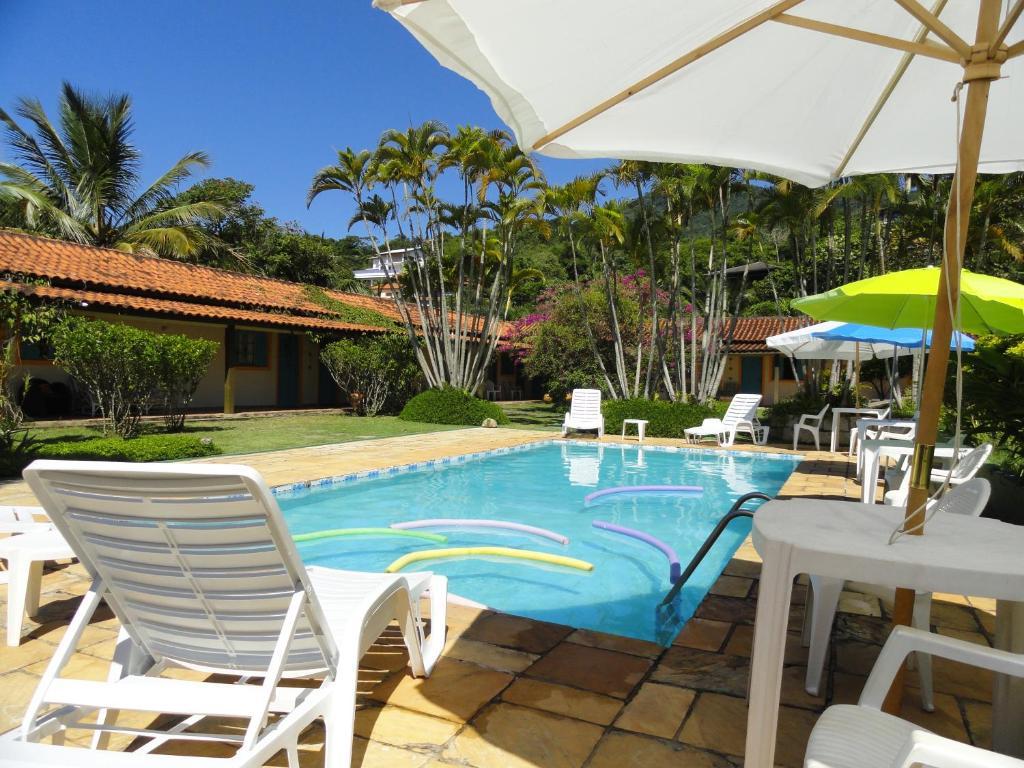 The swimming pool at or near Pousada Praia do Curral