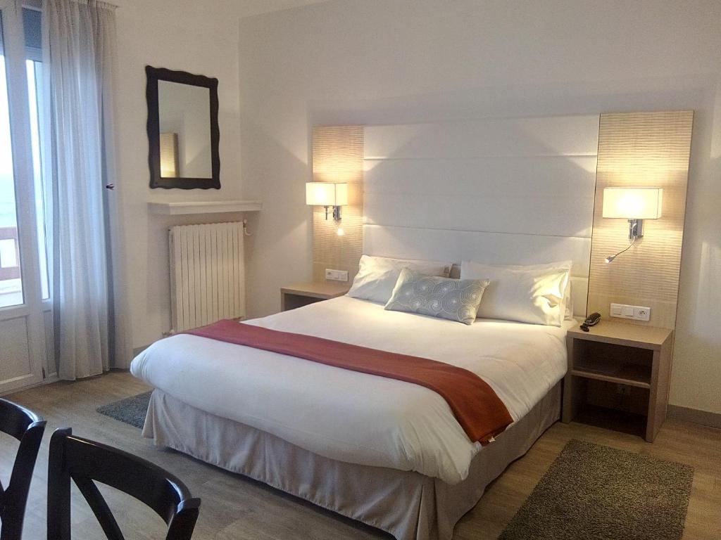 Un ou plusieurs lits dans un hébergement de l'établissement Hotel Uhainak