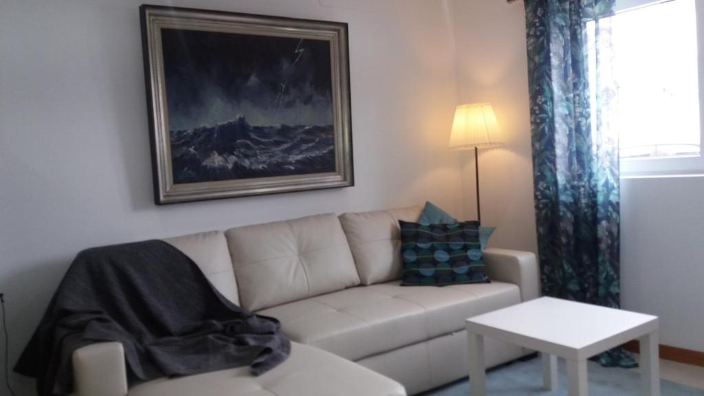A seating area at Appartement Espinho