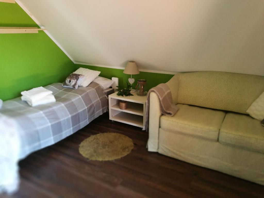A bed or beds in a room at As House