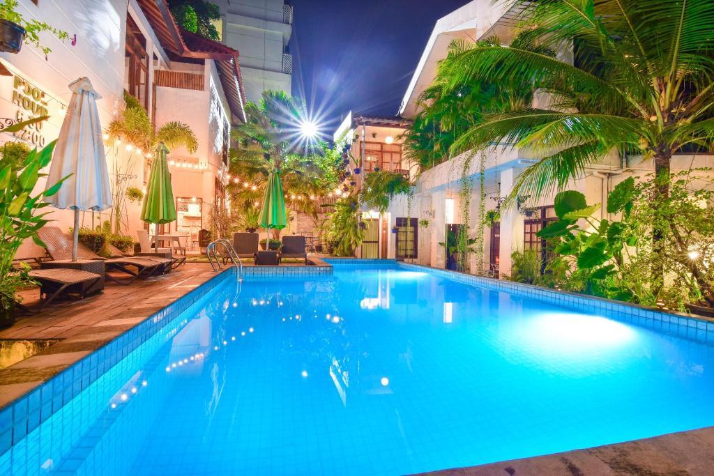 The swimming pool at or near Tiga Lima Homestay