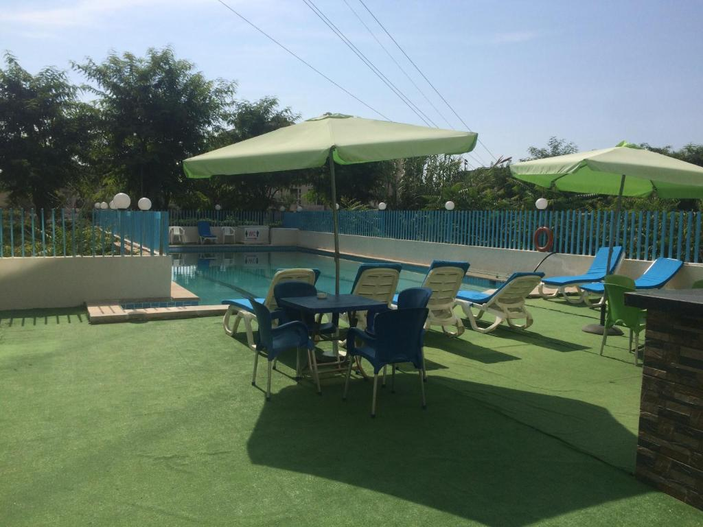 The swimming pool at or near Queens Land Hotel