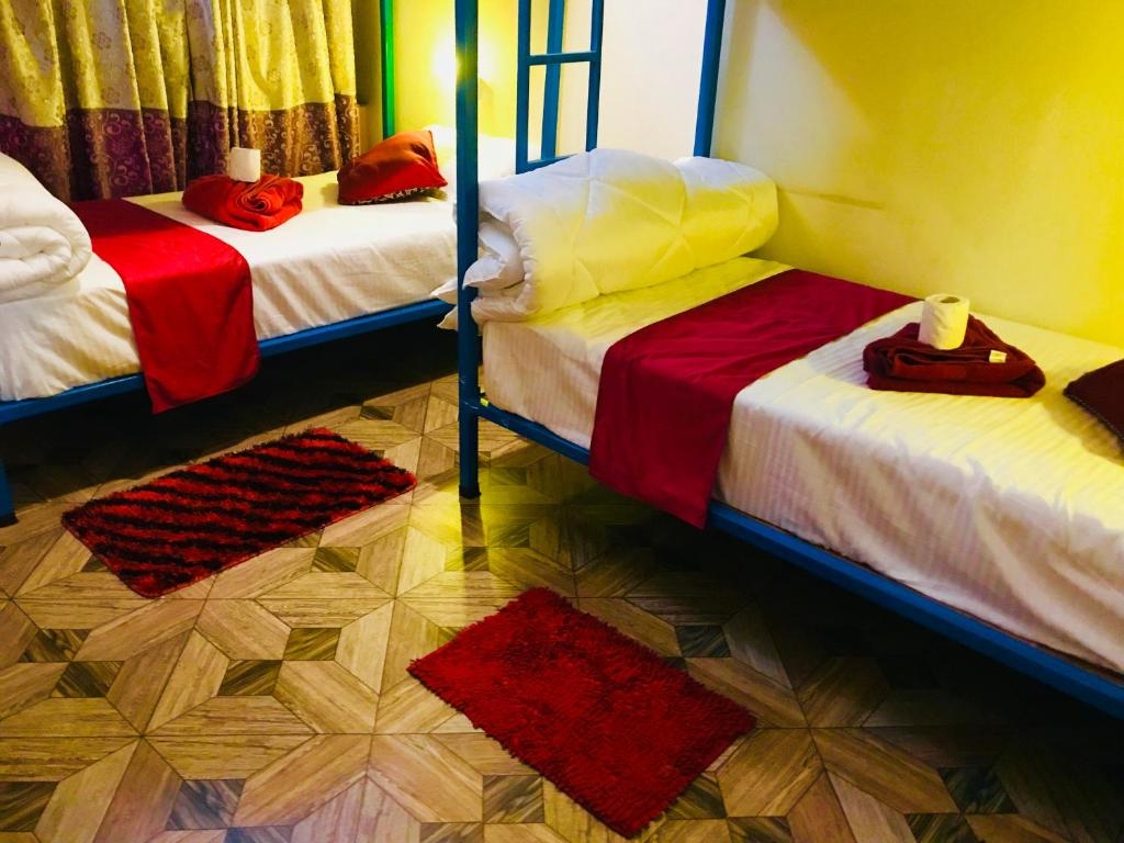 A bed or beds in a room at Aroma Tourist Hostel