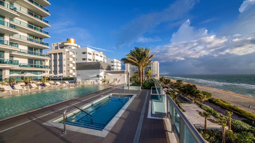 The swimming pool at or near Mare Azur Miami Luxury Apartments by MC