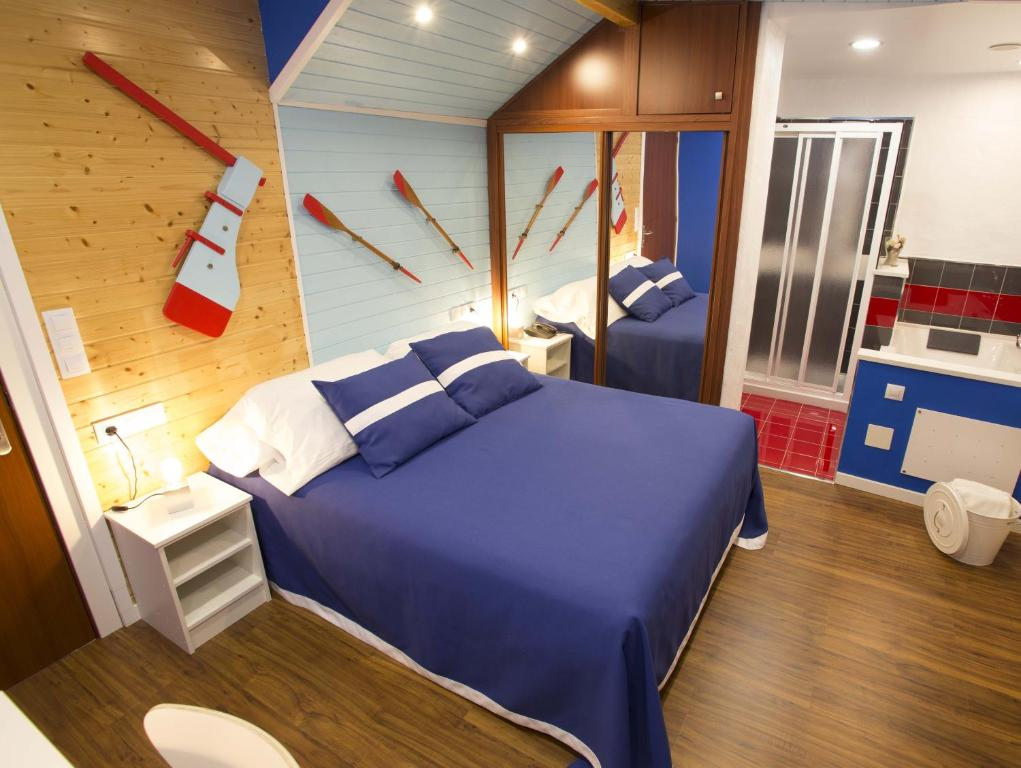 A bed or beds in a room at Hotel A. G. Porcillan