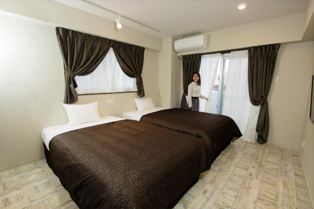 COZY STAY IN GINOMAN房間的床