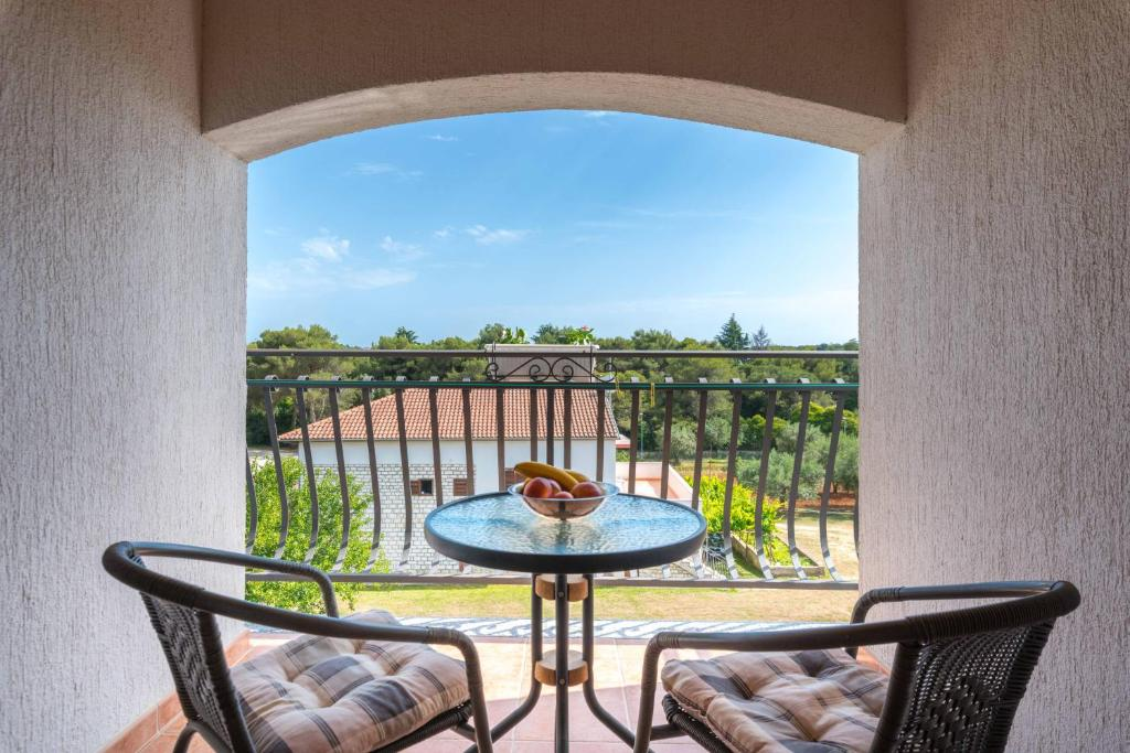 A balcony or terrace at Apartments Villa Tre Marie
