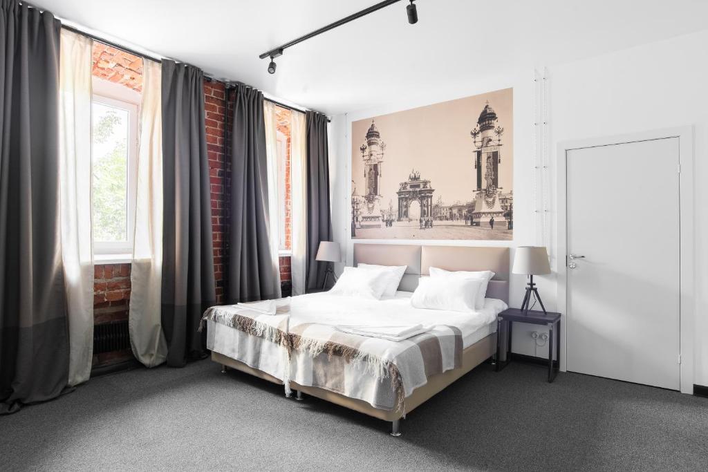 Кровать или кровати в номере Альянс Тверская застава