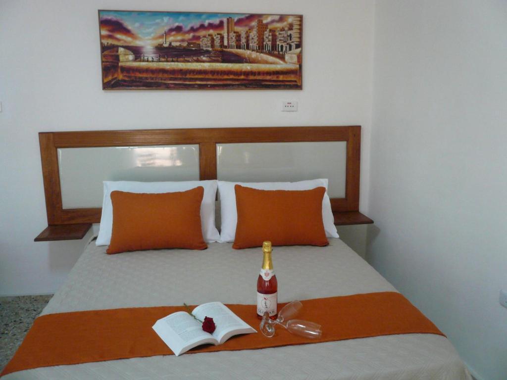 Cama o camas de una habitación en Hostal Málaga Habana