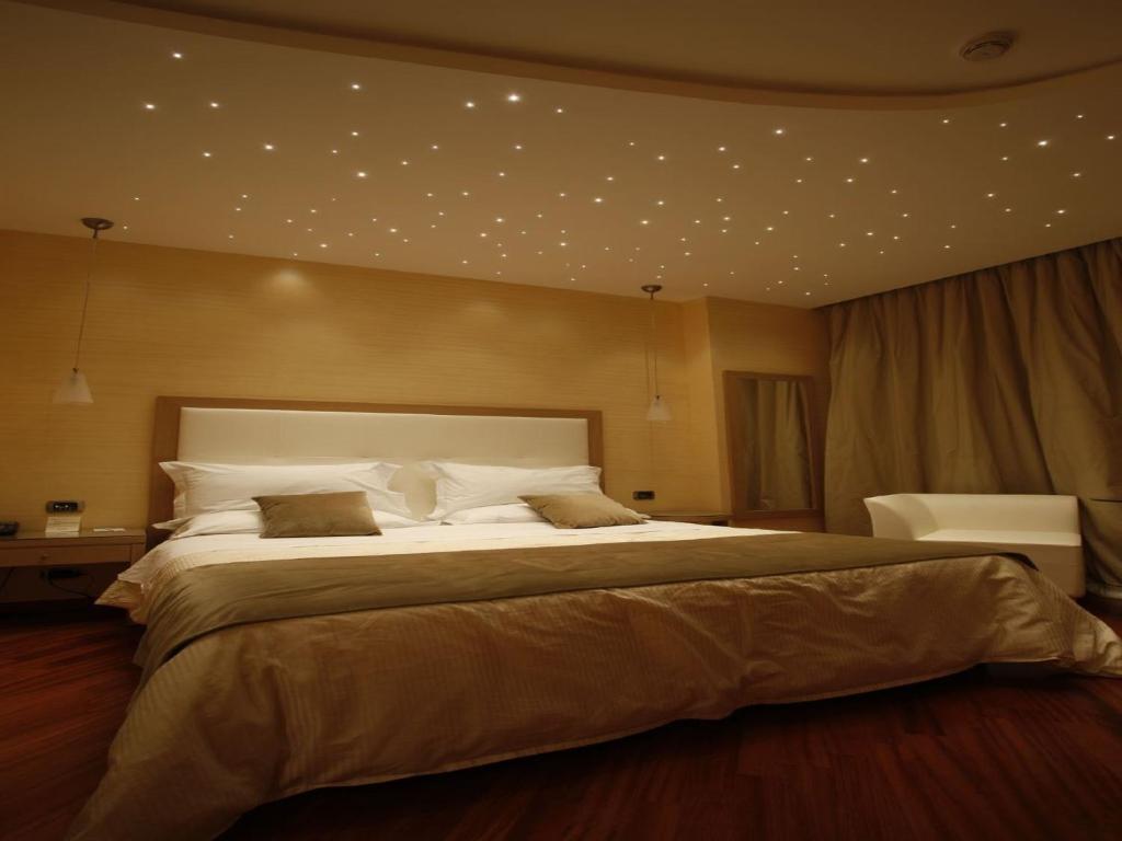 A bed or beds in a room at Hotel Villa Esperia