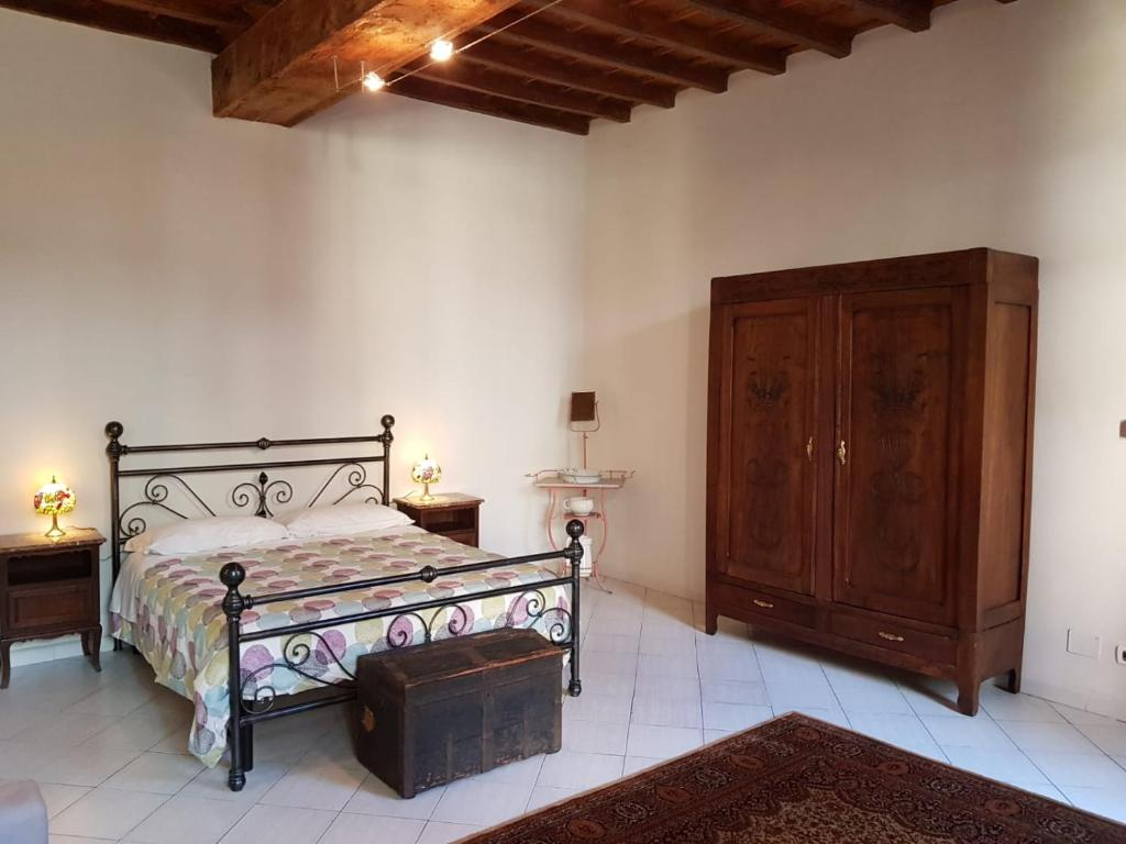 A bed or beds in a room at Casa Castello