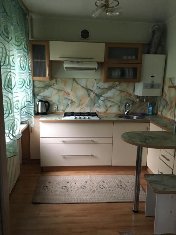 Кухня или мини-кухня в Appartamenty 2