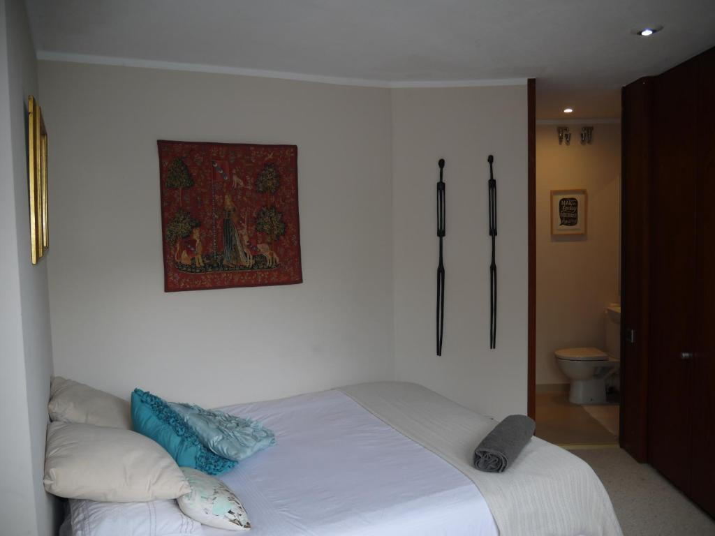 A bed or beds in a room at Bergen Villa