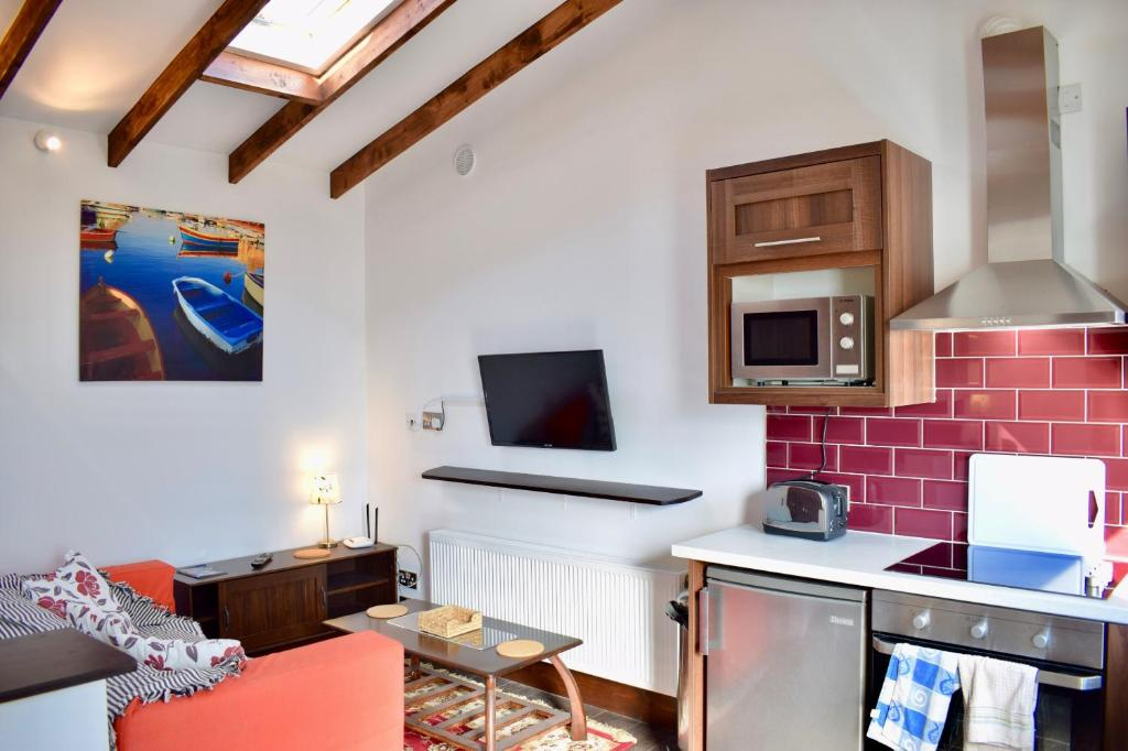A television and/or entertainment center at Studio Apartment in Dublin