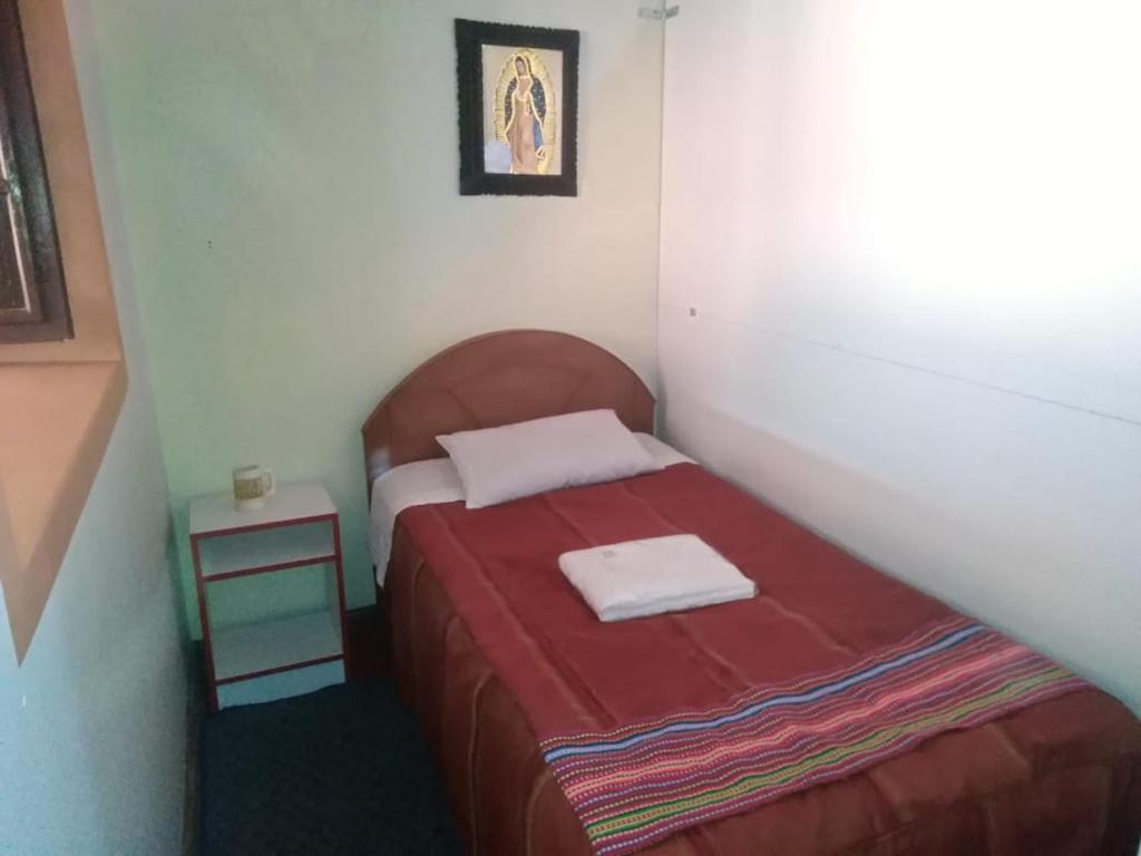 A bed or beds in a room at Shanell guest house