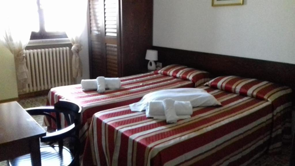 A bed or beds in a room at Il nuovo rifugio