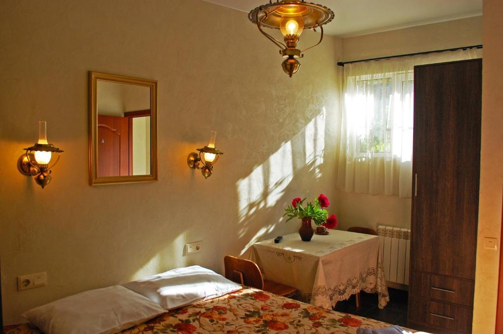 Кровать или кровати в номере Мини Отель Хата