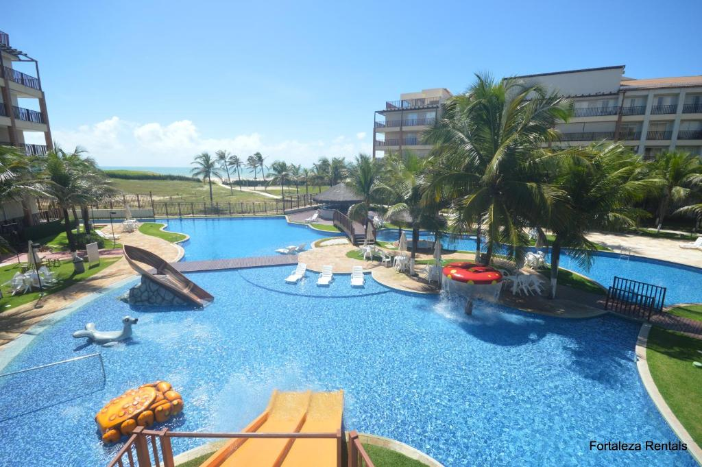 The swimming pool at or near Beach Living Apartment