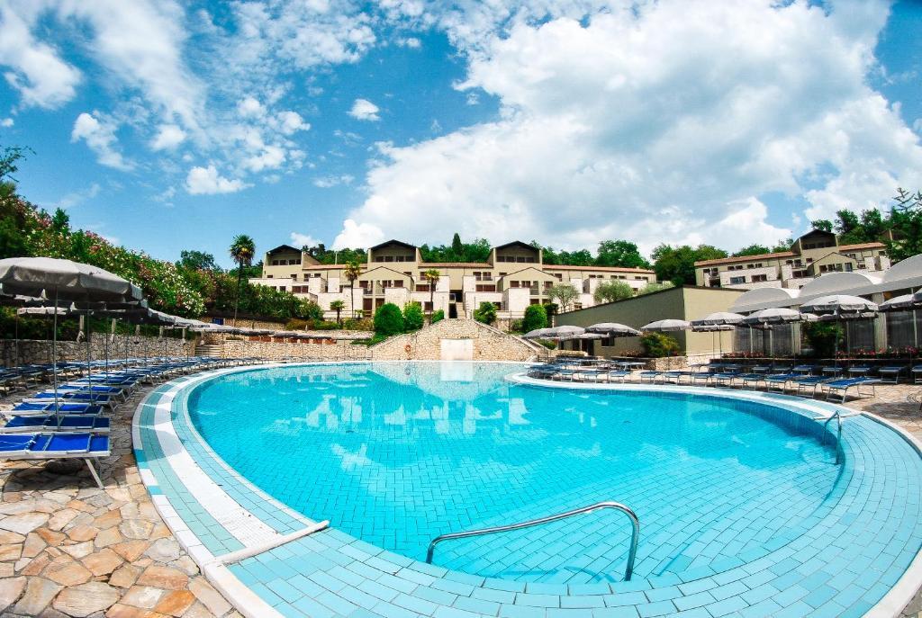 The swimming pool at or near Le Torri Del Garda FamilySPA Resort