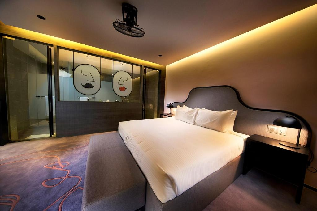 A bed or beds in a room at Resorts World Genting - Theme Park Hotel