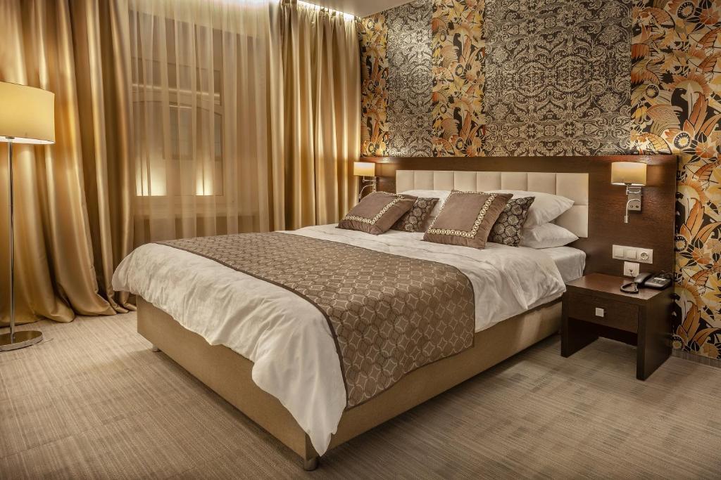 A bed or beds in a room at Myasnitskiy Boutique Hotel