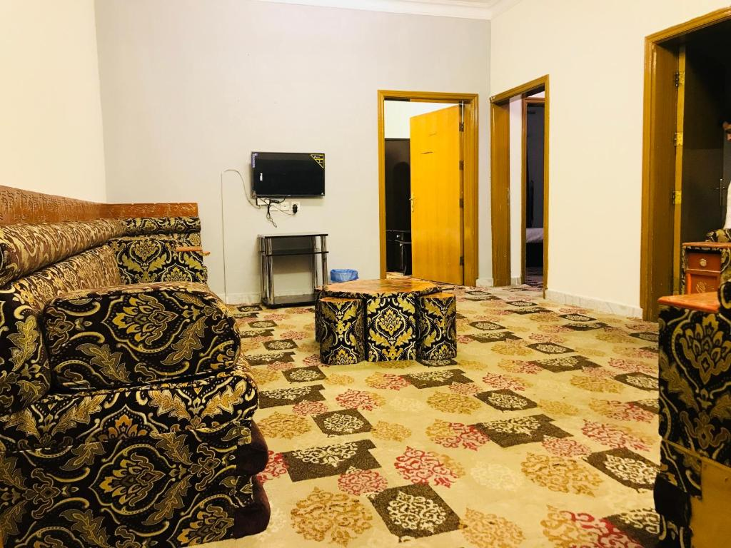 A bed or beds in a room at Mila Suites and Furnished Apartment