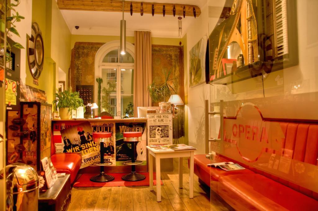 A kitchen or kitchenette at OPERA Hostel