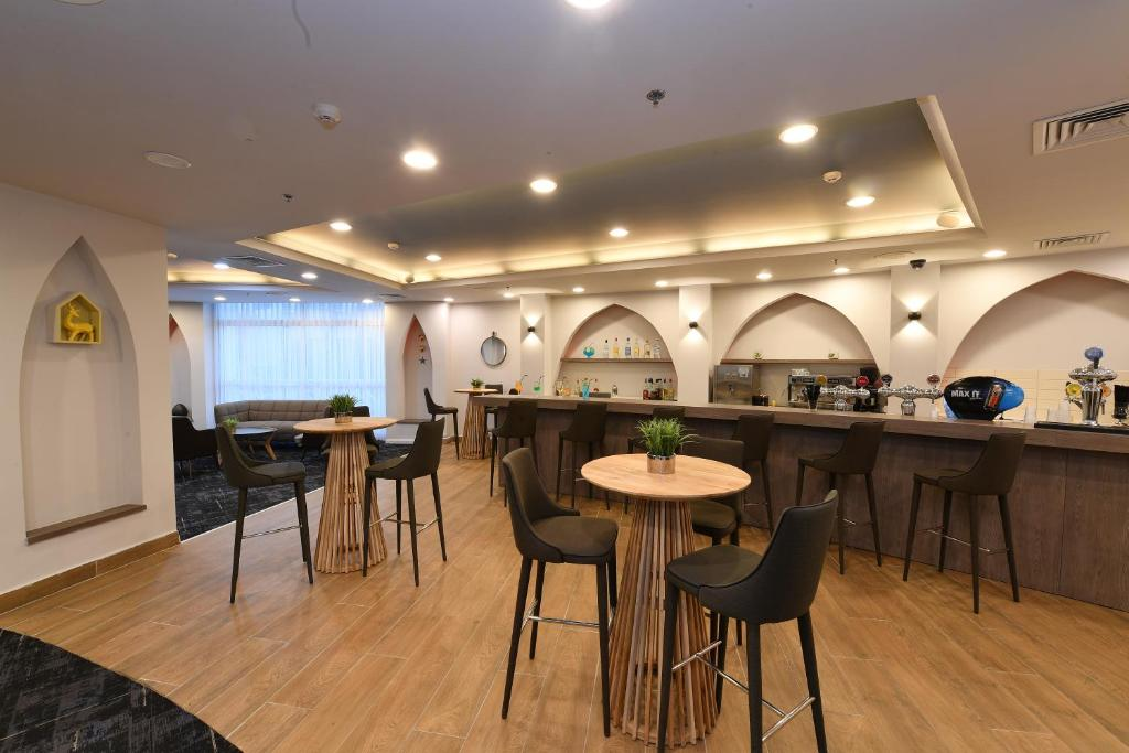 A restaurant or other place to eat at Be Unique Hotel - Drinks included