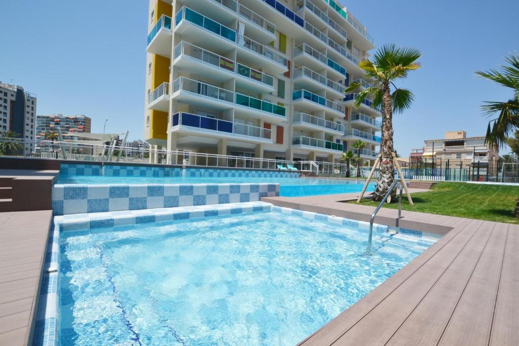 The swimming pool at or near Sea Colors Apartment