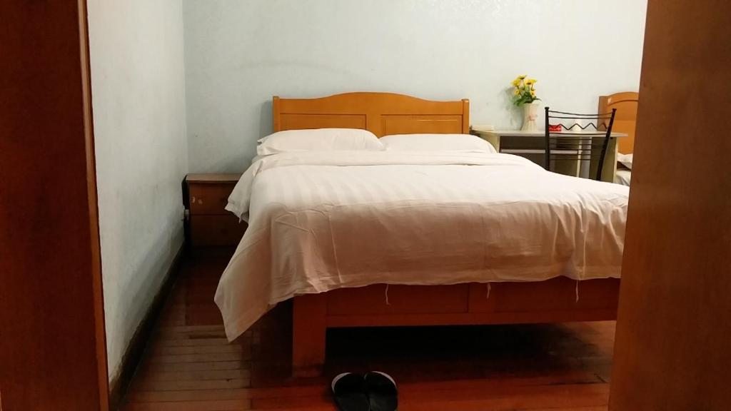 A bed or beds in a room at SX Youth Hostel Chongqing University