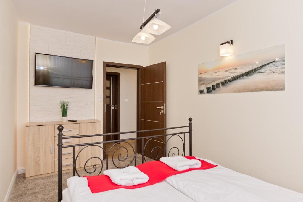 Łóżko lub łóżka w pokoju w obiekcie Pokoje Gościnne Krzyś