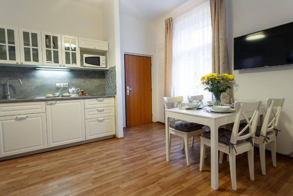 A Kitchen Or Kitchenette At Modern Romantic Apartment Close To Castle