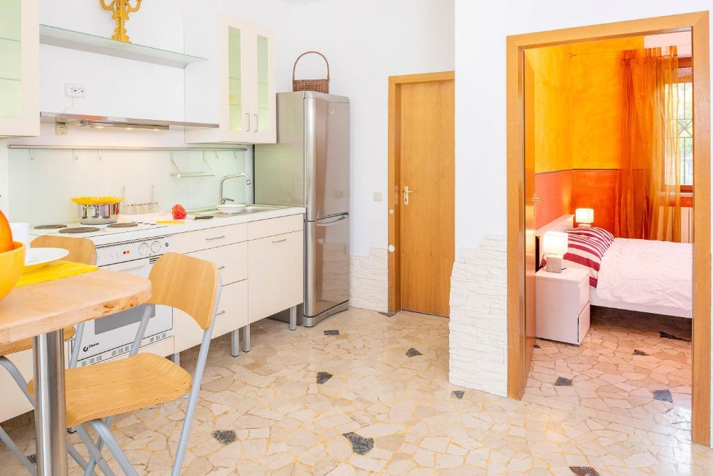 Cucina o angolo cottura di Villa Mattarana - Moderno Appartamento Piano Terra