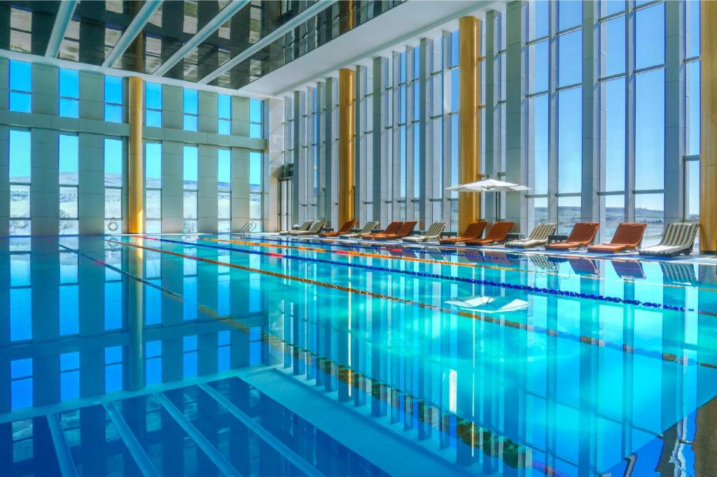 The swimming pool at or near Hotels & Preference Hualing Tbilisi