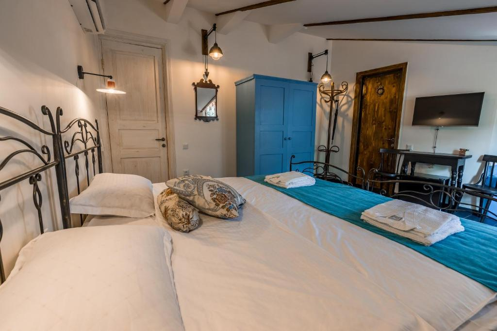 A bed or beds in a room at Doors Meidan Design Hotel