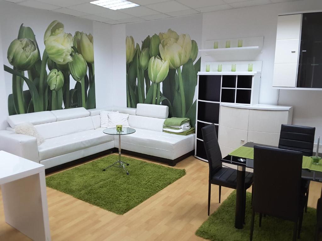 Predel za sedenje v nastanitvi DELUX duplex apartment