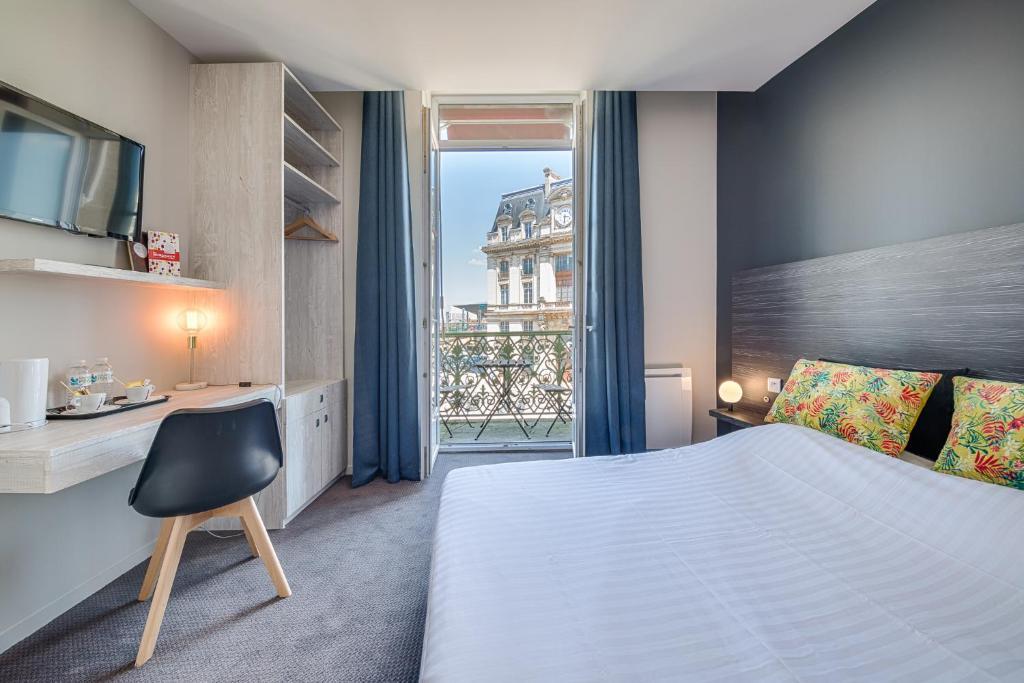 01140f79e8 Un ou plusieurs lits dans un hébergement de l'établissement BDX Hôtel Gare  ...
