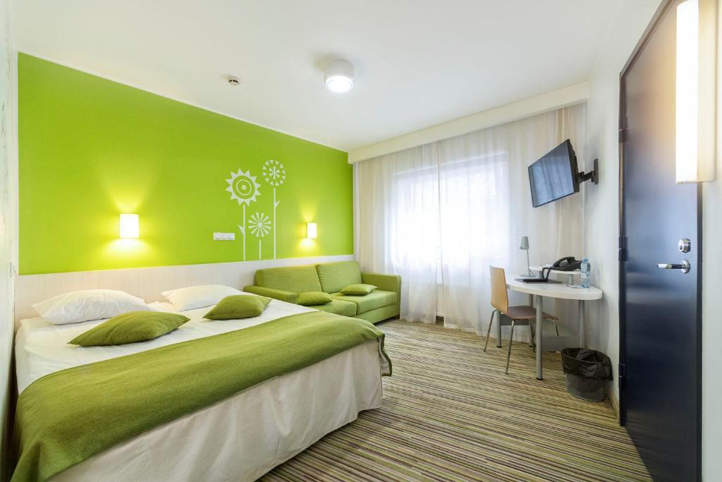 Кровать или кровати в номере Tallink Express Hotel