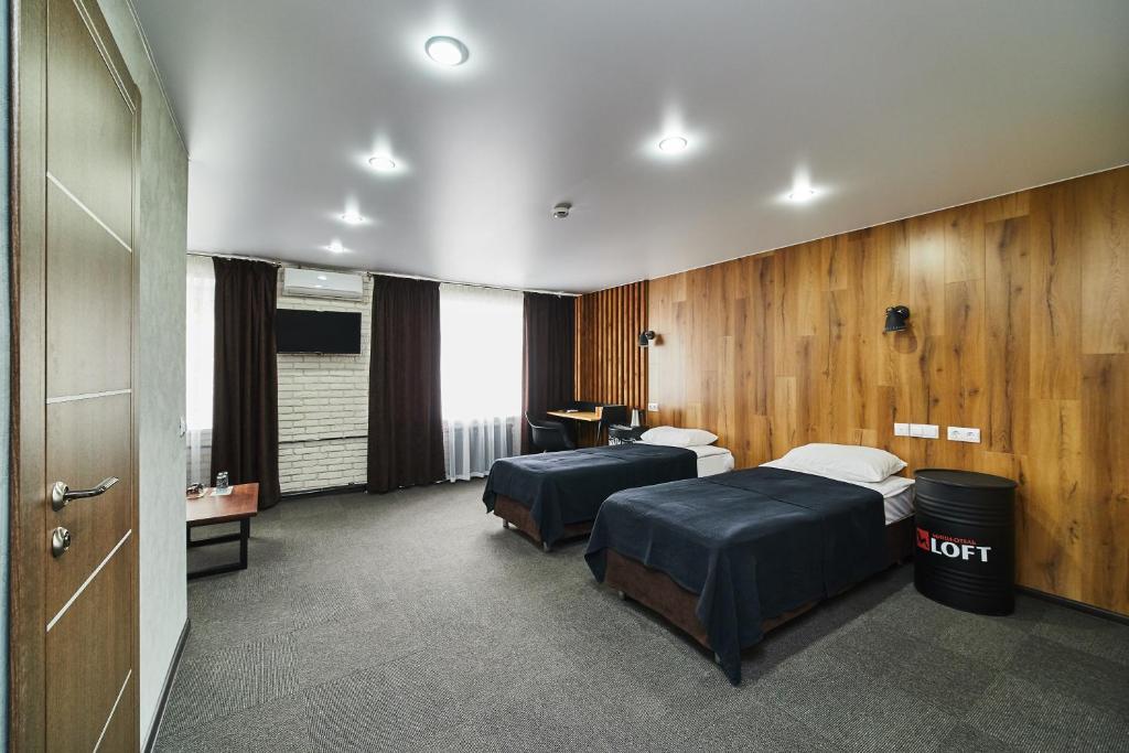 Кровать или кровати в номере Бизнес-отель Loft