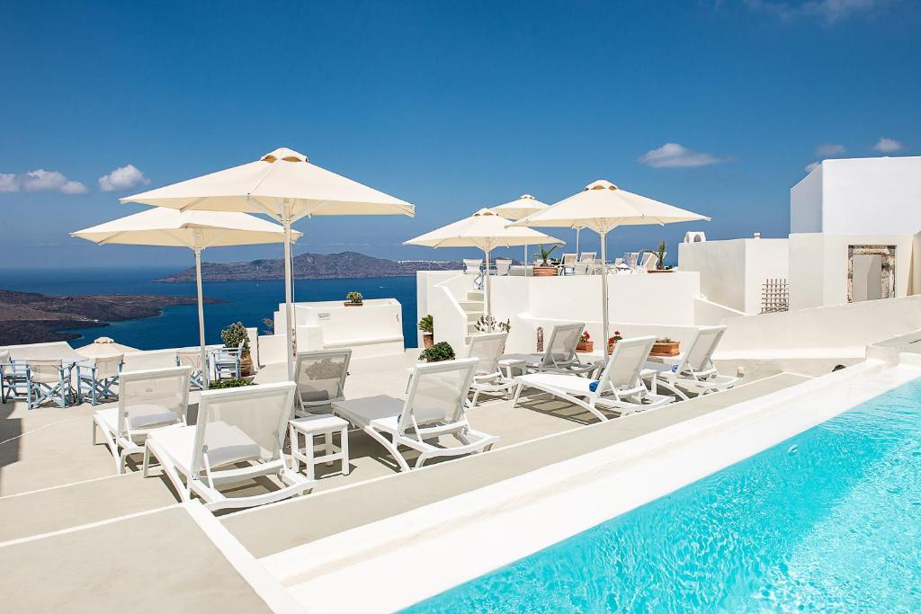 The swimming pool at or near Pantelia Suites