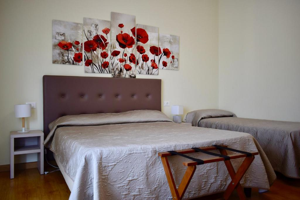 Postel nebo postele na pokoji v ubytování La Lanterna