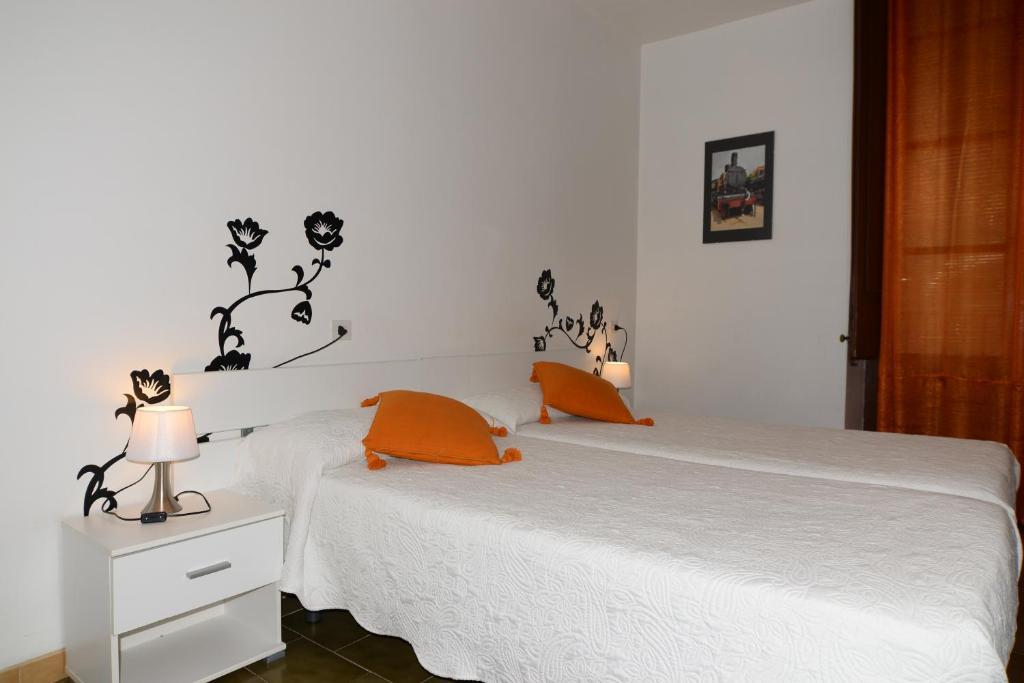 Cama o camas de una habitación en Pensión Borrás