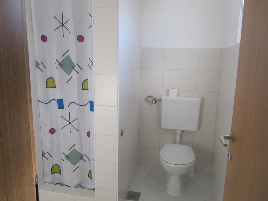 A bathroom at Porat apartment Povljana