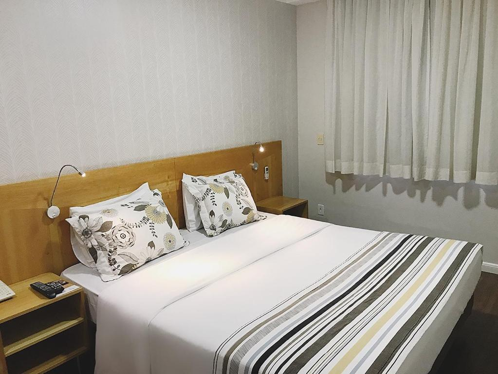 A bed or beds in a room at Marsala Apart Hotel