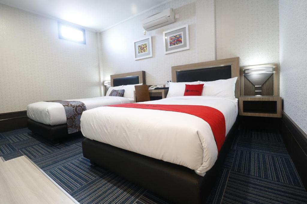 Lova arba lovos apgyvendinimo įstaigoje RedDoorz near Taman Bekapai