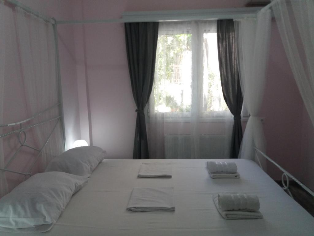 """Ένα ή περισσότερα κρεβάτια σε δωμάτιο στο """"ΙωΚαρ"""""""