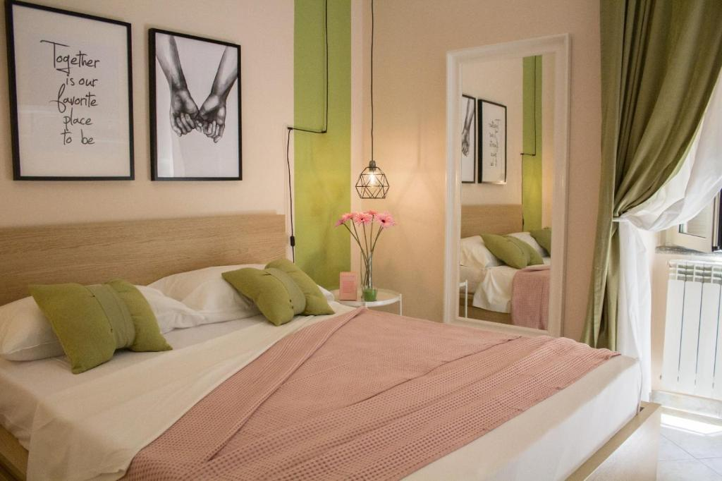 A bed or beds in a room at Apartment Rome & More